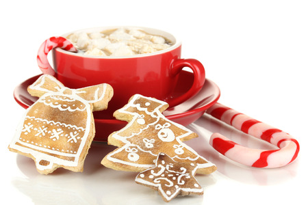 hot drink: Cup of coffee with Christmas sweetness isolated on white Stock Photo