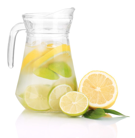 lemon juice: Cold water with lime, lemon and ice in pitcher isolated on white Stock Photo