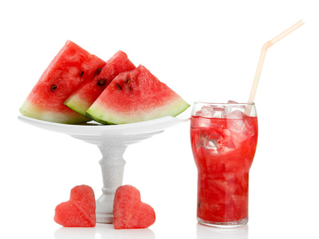 Fresh watermelon and glass of watermelon juice isolated on white photo