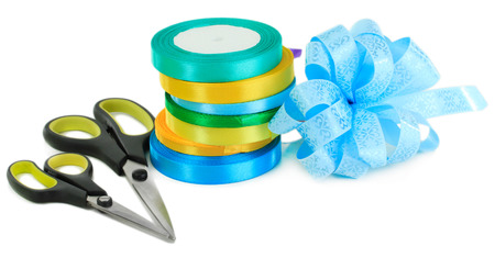 Tapes and bow for wrapping gifts isolated on white photo