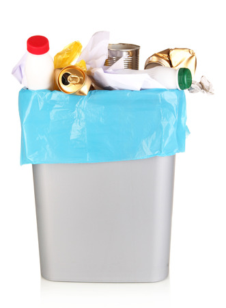 Bin full of rubbish isolated on white photo