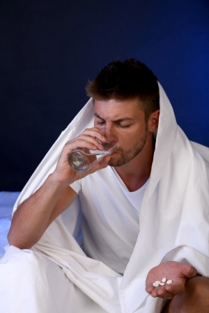 cant: Handsome young man in bed Stock Photo