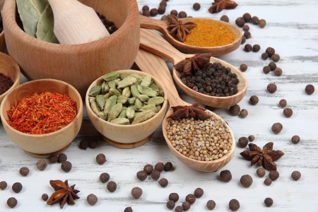 Various spices and herbs on table close up photo