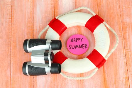 diving save: Lifebuoy on color wooden background