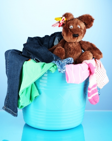 Laundry basket on blue background photo