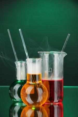 milliliters: Laboratory glassware on dark color background