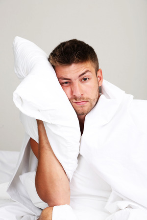 cant: Handsome young man cant sleep in bed Stock Photo