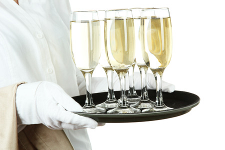 Waitresses holding tray with glasses of champagne, isolated on white photo