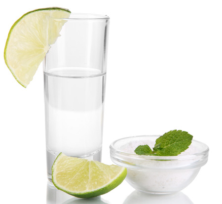 Tequila in glass isolated on white photo