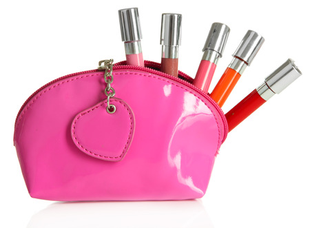 glosses: Beautiful make up bag with lip glosses, isolated on white