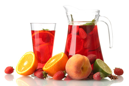 sangria in jar nad glass with fruits, isolated on white photo