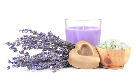 alternative medicine: Lavender candle with soap and fresh lavender, isolated on white