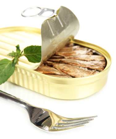 Open tin can with sardines, isolated on white photo