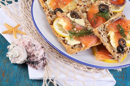 Salmon sandwiches on plate  on wooden table close-up Stock Photo - 22352636