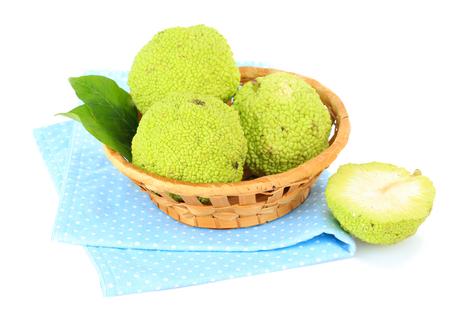 hedgeapple: Osage Orange fruits (Maclura pomifera) in basket, isolated on white