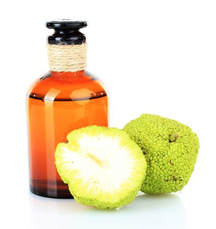 hedgeapple: Osage Orange fruits (Maclura pomifera) and medicine bottle, isolated on white