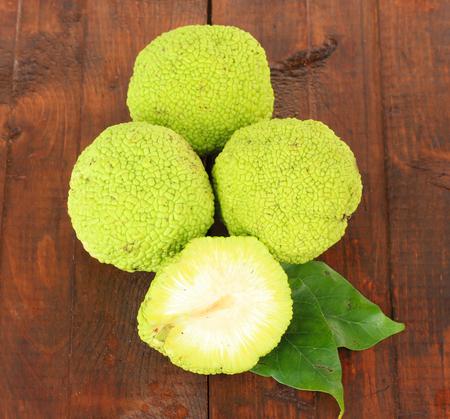hedgeapple: Osage Orange fruits (Maclura pomifera), on wooden background Stock Photo