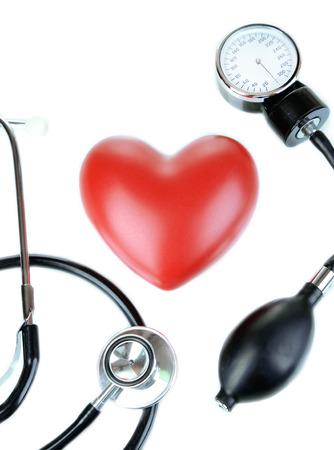 Tonometer, stethoscope and heart isolated on white Stock Photo - 22353371
