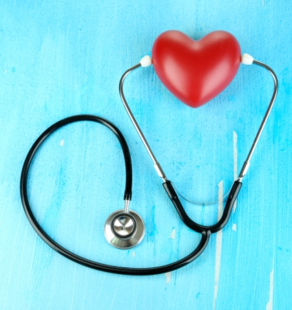 Stethoscope and heart on wooden table close-up Stock Photo - 22353375
