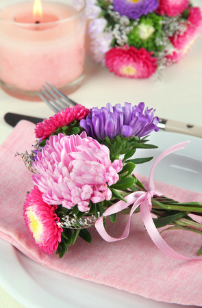 Festive dining table setting with flowers photo