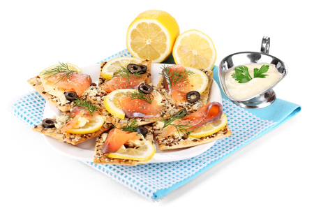 Salmon sandwiches on plate  isolated on white photo