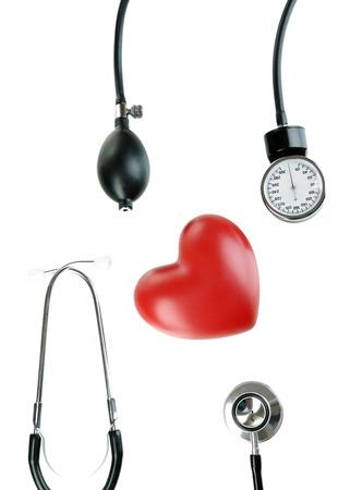 Tonometer, stethoscope and heart isolated on white Stock Photo - 22457633