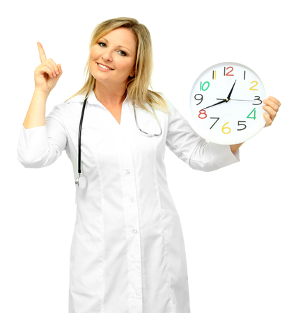 Young beautiful doctor with stethoscope and clock, isolated on white photo