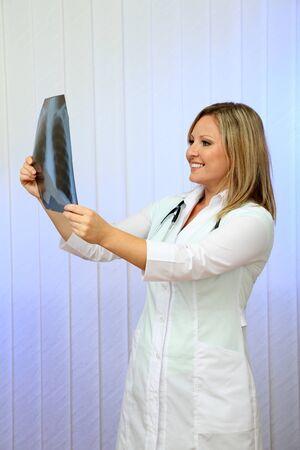 Medical doctor analysing x-ray image  on light background Stock Photo - 24366871