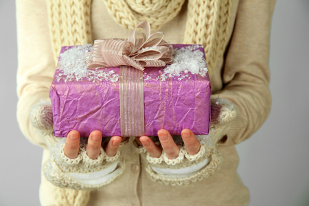 Female hands with gift box, close-up photo