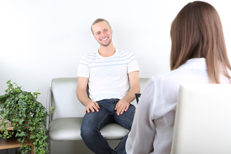 Talking to psychologist during counseling Stock Photo