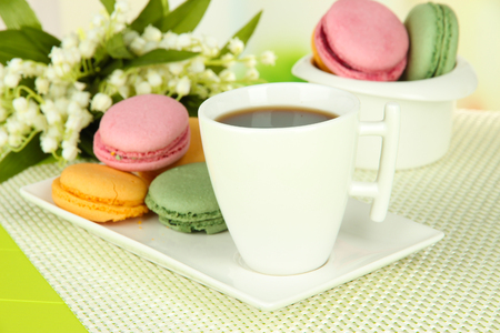 Coffee and macaroons on table close-up photo