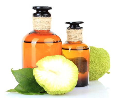 hedgeapple: Osage Orange fruits (Maclura pomifera) and medicine bottles, isolated on white