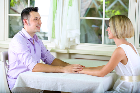 Beautiful couple having  romantic date at restaurant photo