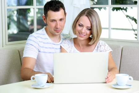Young couple  with laptop, at home photo