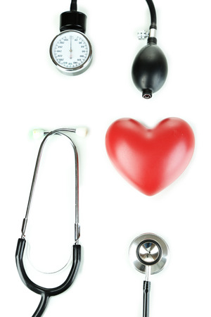 Tonometer, stethoscope and heart isolated on white Stock Photo - 22587280