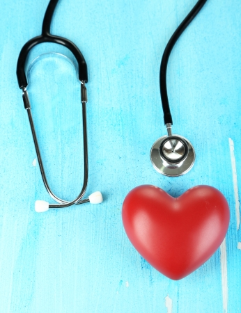 hypertensive: Stethoscope and heart on wooden table close-up Stock Photo