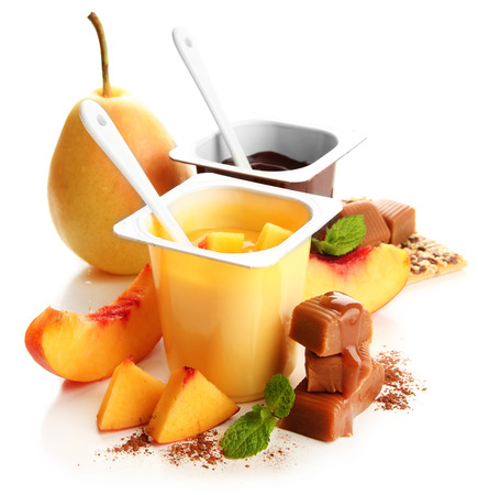 Composition with tasty desserts, pieces of fresh fruits and toffee candies,  isolated on white photo