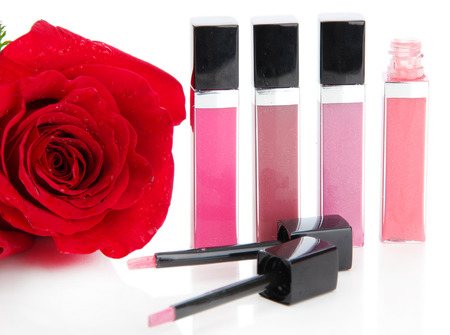 Beautiful lip glosses, isolated on white photo
