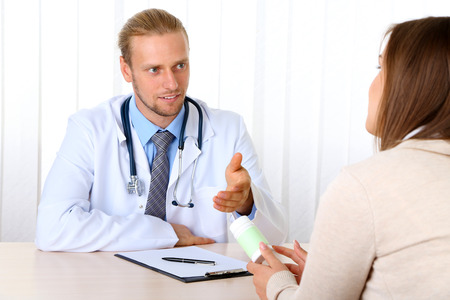 depletion: Doctor and patient at office