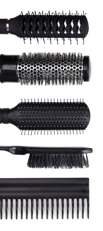 Black combs isolated on white photo