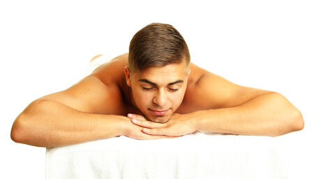 Young man relaxed in spa salon  photo