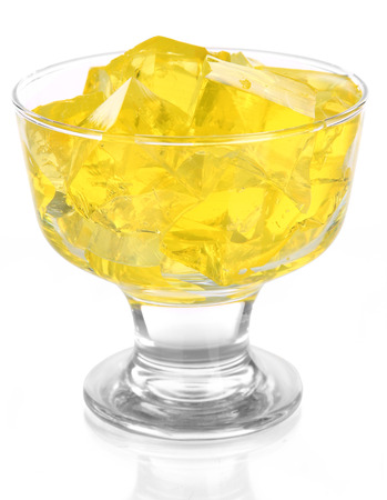 Tasty jelly cubes in bowl isolated on white photo