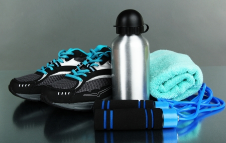 Different tools for sport on grey background photo