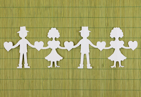Paper people in social network concept on green bamboo background photo