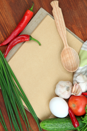 Cooking concept. Groceries with empty cookbook close up photo
