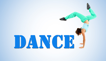 Young modern dancer posing, on blue background photo