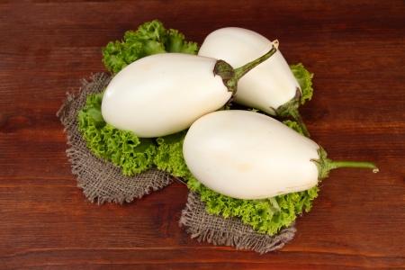 Fresh eggplants on table close-up photo