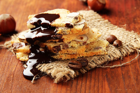 Biscotti with  nuts, on wooden background photo