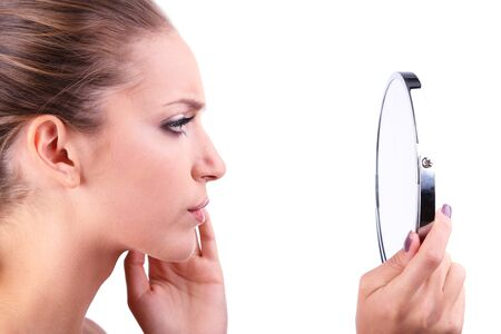 preens: Beautiful girl preens before small mirror isolated on white Stock Photo