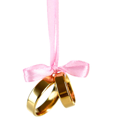 wedding accessories: Wedding rings tied with ribbon isolated on white